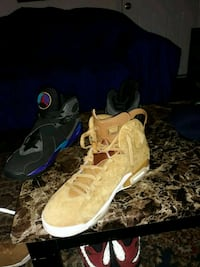 pair of brown-and-black Nike basketball shoes 524 mi