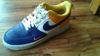unpaired blue, white, and yellow Nike Air Force 1