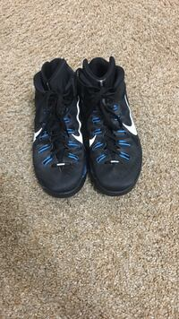 pair of black-and-white Nike basketball shoes