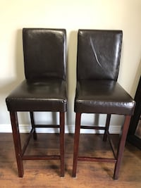 Two black leather padded chairs. Height 45. Mississauga, L5M