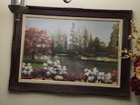 landscape painting with black frame