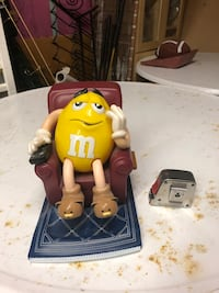 M&M guy in chair. 1999 Surrey, V3V 7L9