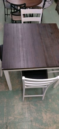 Dining table with four bar stool height chairs