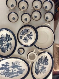 White and blue ceramic tea set, food container and three oval trays
