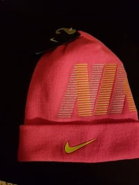 pink and yellow Nike knit cap