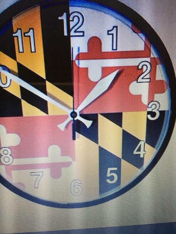 Wall clock of maryland with a build in carbon alarm