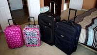 4 suitcases for $60. 2 wheels. All works Allen
