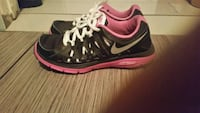pair of black-and-pink Nike running shoes Montréal, H4E 1L4