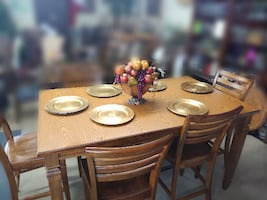 Tall Oak wood dinning room table with 6matching chairs