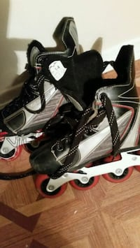 pair of black-and-white inline skates Longueuil, J4K