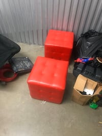 2 red leather ottomans