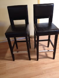 two brown leather barstools with wooden base