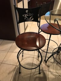 Espresso style tall rod iron chairs (set of 4) with round glass table top and rod iron base