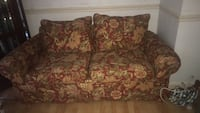 brown and red floral loveseat Alexandria, 22315