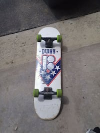 white, black, and green skateboard Welland