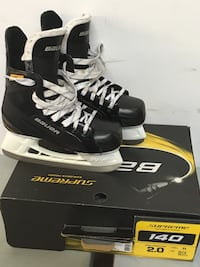 pair of black Bauer ice skates with box Riverview, E1B 4E7