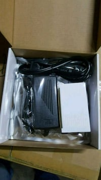 black and gray corded electronic device with box Delta, V4C 2L4