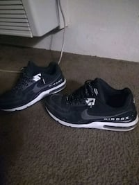 pair of black-and-white Nike running shoes Las Vegas, 89169