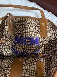 Authentic Mcm tote bag with wristlet on clearance  537 km