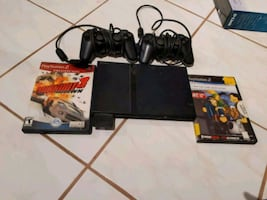 PS2 with 2 remote control and 2 games- very good condition