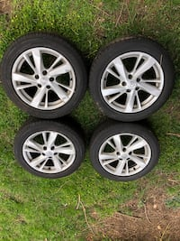 Four gray 5-spoke vehicle wheels and tires.  Stock from a Nissan Altima  Glyndon, 21071