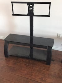 Glass tv stand and glass table $50 each or $90 both Toronto, M9R 1T1