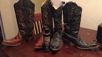 two pair black and brown cowboy boots