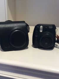 black poloroid camera  with case  Clifton, 20124
