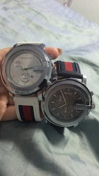two round black chronograph watches Silver Spring
