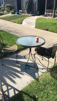 round black metal patio table with four chairs Seal Beach, 90740