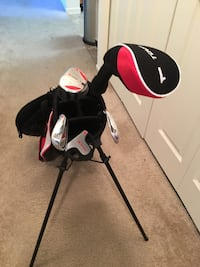 black, red and white golf bag with golf club set
