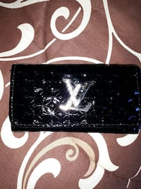 black Louis Vuitton leather wallet