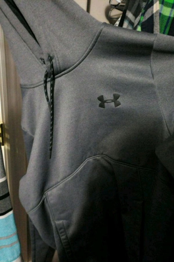 gray and black Under Armour backpack