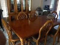 rectangular brown wooden table with six chairs din Highland, 92346