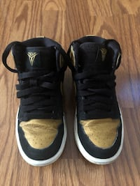 Black & gold Jordan  shoes size 11.5