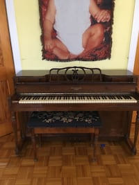 brown wooden framed upright piano FREEPORT