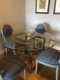Crate and Barrel round glass top/grey wood base dining room table New York, 10128