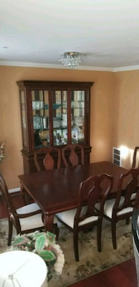 Dining table with 6 chairs and a China Cabinet. Laurel, 20707