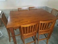 rectangular brown wooden table with four chairs dining set Fox Island, 98333
