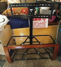 black metal framed brown wooden TV stand Montreal