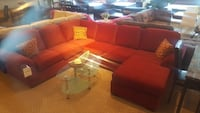 red sectional sofa with clear glass coffee table