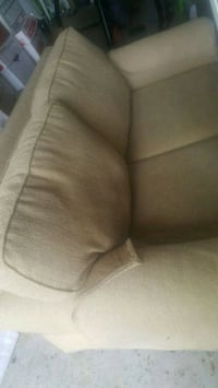 Light brown beige love seat good condition Sunrise, 33351