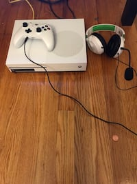 white Xbox One console with controller 143 mi