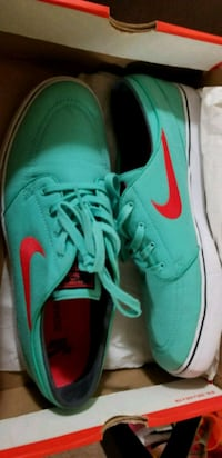 pair of green Nike low-top sneakers Calgary, T2A 6G8