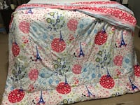 White, red, and blue floral comforter. Queen size Houston, 77084