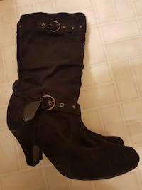 pair of black pump mid-high boots