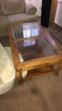 brown wooden framed glass top coffee table Riverside, 92508