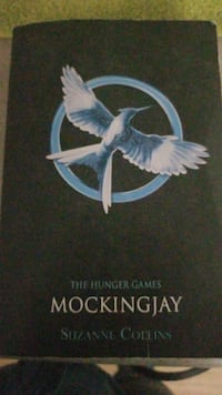 blue and black The Hunger Games Mocking Jay by Suzzane Collins book