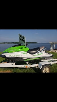 green and white personal watercraft Middletown, 21769