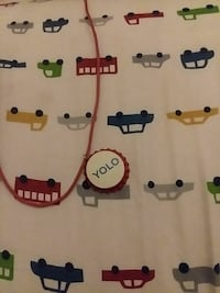 white, gray, red, yellow, and green cars printed textile